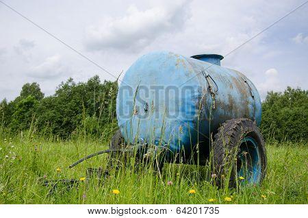 Blue Water Cistern Drink For Farm Animal In Meadow