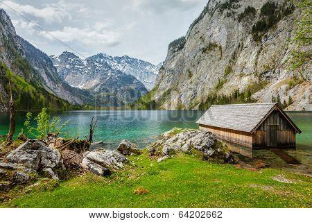 Boat dock hangar on Obersee mountain lake in Alps. Bavaria, Germany