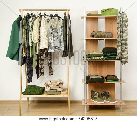 Wardrobe with camo pattern clothes, shoes and accessories.