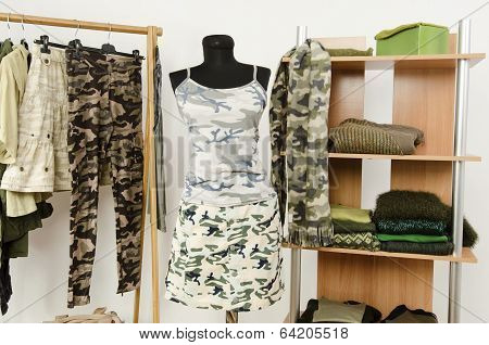 Wardrobe with camo pattern clothes and accessories.