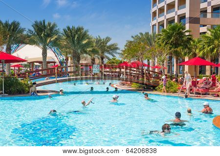 ABU DHABI, UAE - MARCH 28: People resting at the pool area of Khalidiya Palace by Rotana on March 28, 2014, UAE. Rotana Hotel Corporation has 85 properties in 26 cities around Middle East and Africa.