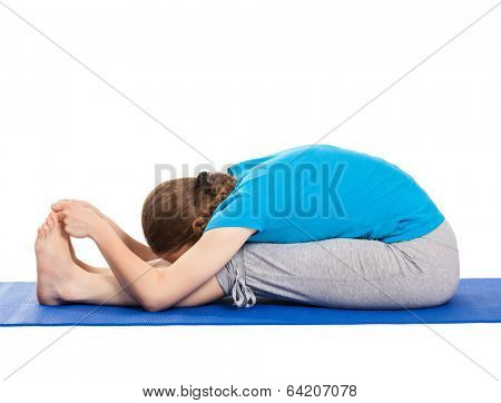 Yoga - young beautiful slender woman yoga instructor doing Seated Forward Bend or Intense Dorsal Stretch pose asana (Paschimottanasana) exercise isolated on white background