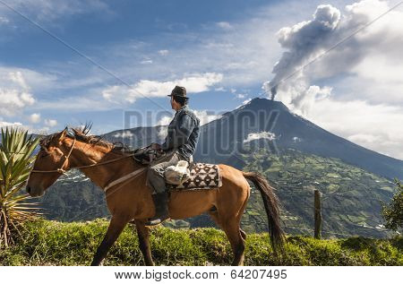 Farmer on a horse looking at the  Tungurahua volcano eruption