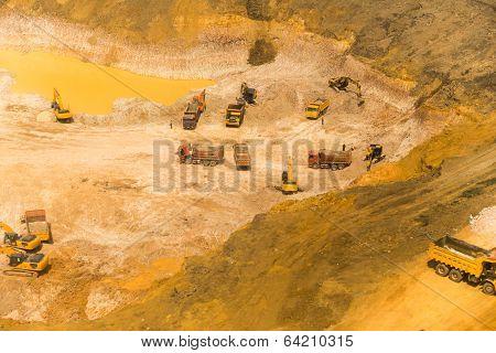 Wheel Loader Excavator Unloading Sand, Tractors And Dump Truck Inside Construction Site