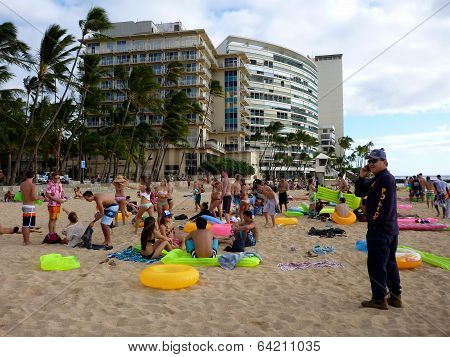Honolulu Police Officer Calls For Backup As He Inspects Beach Party Of Young People With Water Float