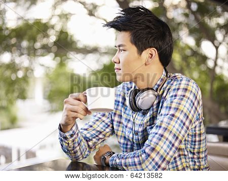 Young Man In Coffee Shop