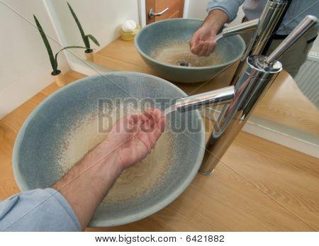 Hands in a sink