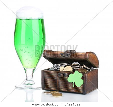 Glass of green beer and chest with coins isolated on white
