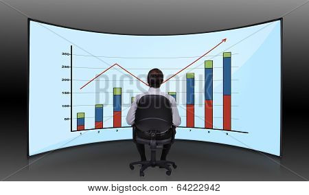 Businessman Looking At Chart