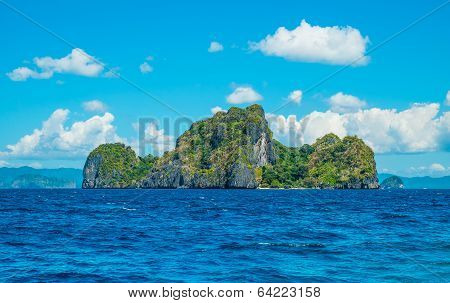 Scenic View On Green Rocky Island