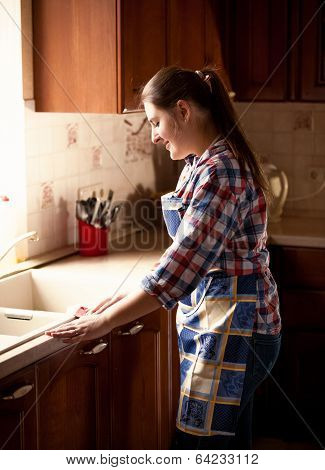 Beautiful Woman Cleaning Kitchen With Cloth