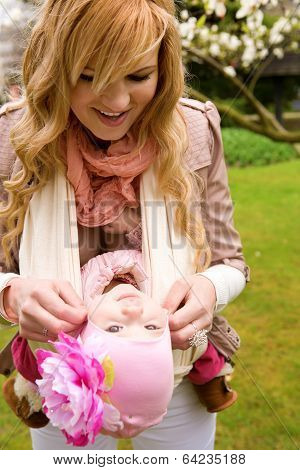 Young Mother And Baby Daughter Having Fum Outdoors