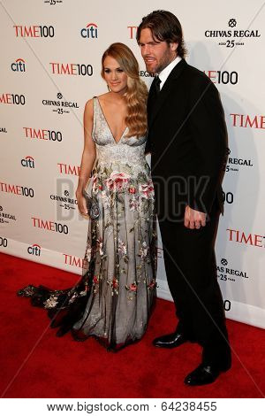 NEW YORK-APR 29: Singer Carrie Underwood & husband Mike Fisher attend the Time 100 Gala for the Most Influential People at Frederick P. Rose Hall at Lincoln Center on April 29, 2014 in New York City.