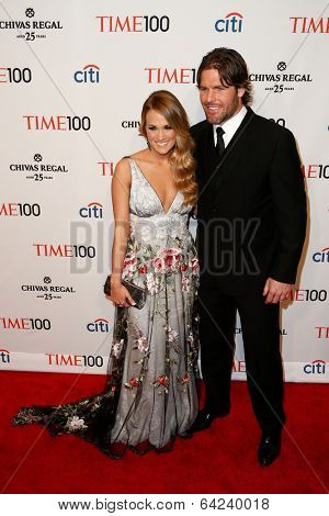 NEW YORK-APR 29: Singer Carrie Underwood (L) and Mike Fisher attend the Time 100 Gala for the Most Influential People at Frederick P. Rose Hall at Lincoln Center on April 29, 2014 in New York City.