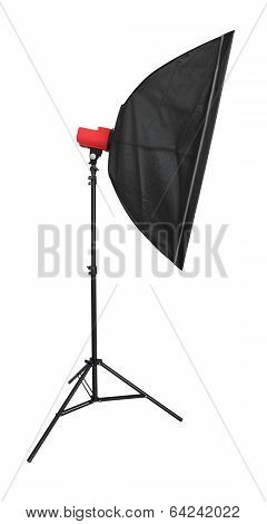 Strobe flash light with stand and softbox on white background.