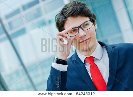 Outdoor portrait of cheerfull young executive leader