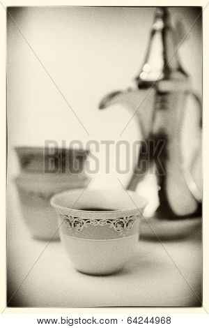 Arabic coffee mugs and kettle - grainy black and white photo effect