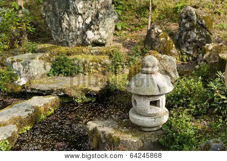 Japanese style garden with stone lantern in Japan, Asia.
