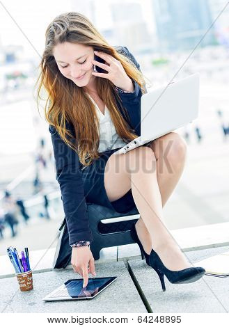 Junior Executive Dynamic Phoning Outside Of Her Office