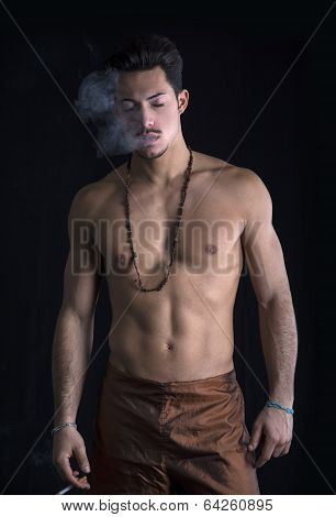Athletic Shirtless Young Man With Mustache Smoking