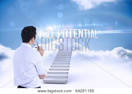 The word full potential and businessman holding glasses against shut door at top of stairs in the sky