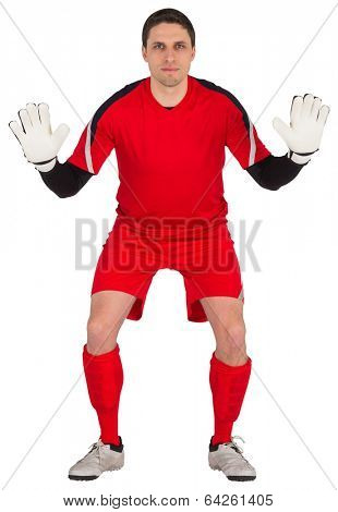 Fit goal keeper looking at camera on white background