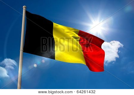 Belgium national flag on flagpole on blue sky background