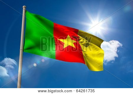 Cameroon national flag on flagpole on blue sky background