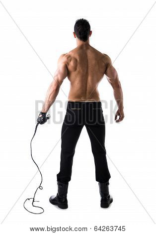 Full Body Shot Of Muscular Man With Whip And Leather Glove, Seen From The Back