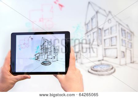 Taking a photo of a design drawing on a whiteboard, using a tablet