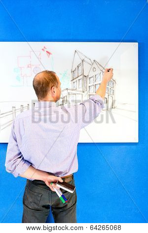 Sketch artists standing in front of a whiteboard, drawing a concept of an architectural design of a residential structiure