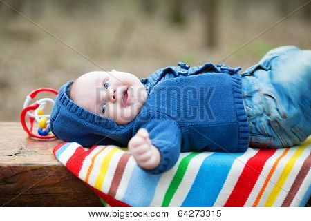 Adorable 4 Month Baby Boy Lying On His Back
