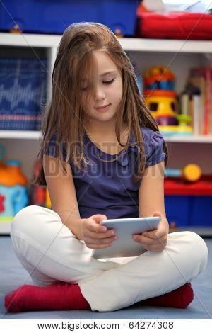 Happy Pre-teen Girl Using A Digital Tablet Computer