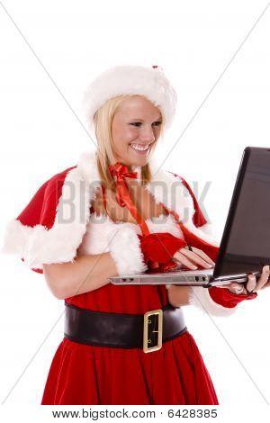 Santas Helper Making List With Laptop