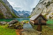 image of dock a lake  - Boat dock hangar on Obersee mountain lake in Alps - JPG