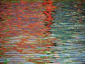 stock photo of swim meet  - Red Blue Color pattern shimmers and reflects in ripples of water making a psychedelic pattern - JPG