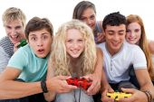 Excited Teenagers Playing Video Games In The Living-room poster