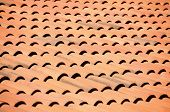 stock photo of gusset  - Old red tiles roof background - JPG