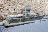 stock photo of trough  - Old fountain and drinking trough in Burgo de Osma Soria Spain - JPG