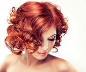 stock photo of hair curlers  - Beautiful model with red curly hair  - JPG