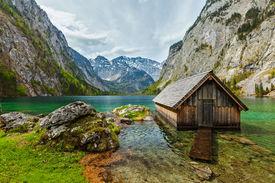 stock photo of dock a lake  - Boat dock hangar on Obersee mountain lake in Alps - JPG