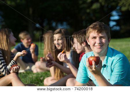 Teen Male Holding An Apple