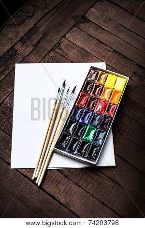 Art Tools - Colorful Aquarelle Paints In A Box. Watercolor Paints And Brushes With Blank White Paper