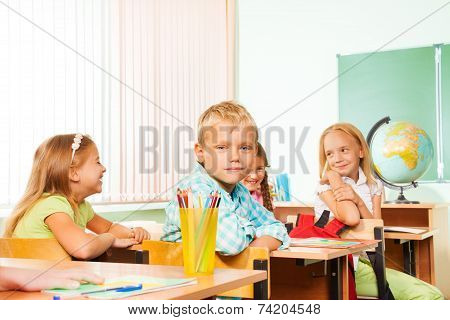School children sitting at tables during geography