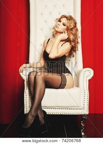 princess woman in lingerie sitting on throne