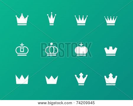 Crown icons on green background.