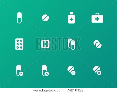 Pills, medication icons on green background.