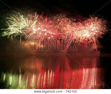 Fireworks in the night sky over the lake