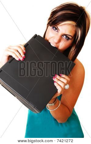 A Young Girl Angry Bite At Her Laptop.
