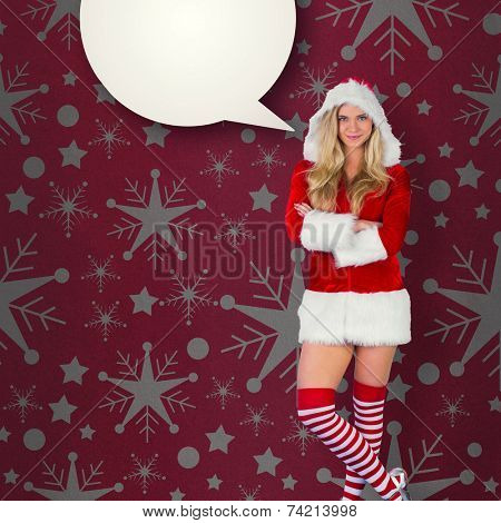 Pretty girl in santa outfit with arms crossed against red vignette